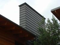 Дымоход, облицованный в двойной фальц цинк-титаном Rheinzink Германия. Частный жилой дом в с.Козин Обуховского района.